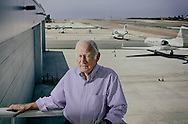 Entrepreneur Ted Vallas,95, stands at the McClellan-Palomar Airport, which he founded, on Thursday, April 14, 2016 in Carlsbad, CA.(Photo by Sandy Huffaker for The New York Times)