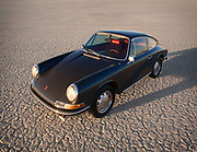 Image of a Slate Gray 1966 Porsche 911 on a dry lake bed in California, American Southwest by Randy Wells