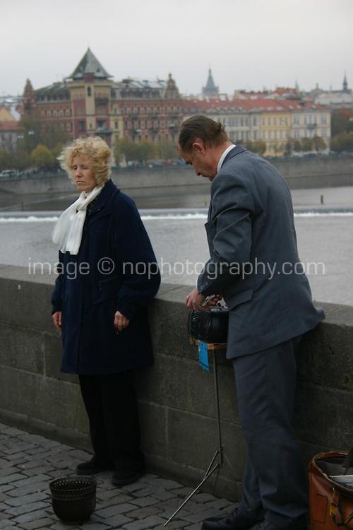 Opera singer busker on The Karluv, Charles medieval Bridge, Prague, River Vltava, Czech Republic<br />