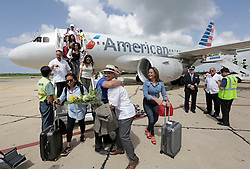 American Airlines executive Gabriel Crespo greets travel agents on the tarmac as they arrive in Cienfuegos on American Airlines' inaugural scheduled service from Miami to Cuba. Photo by Al Diaz/Miami Herald/TNS/ABACAPRESS.COM