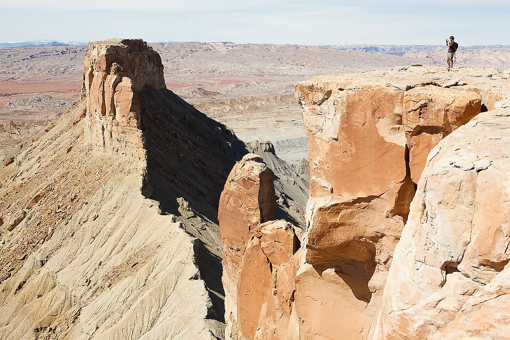 Leif Anderson, on a geology field trip with the University of Colorado, takes pictures standing the rim of North Caineville Mesa, Utah.