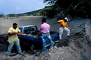 The tropical Caribbean island of Montserrat which has suffered badly since the eruption of the Soufriere Hills volcano 10 years ago. Two thirds of the island is out of bounds to everyone except scientists. Photo shows workers collecting mud and ash deposits to use in construction..Photo©Steve Forrest/Workers Photos