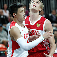31 July 2012: Russia Andrei Kirilenko vies for the rebound with China Peng Zhou during the 73-54 Russia victory over China, during the men's basketball preliminary, at the Basketball Arena, in London, Great Britain.