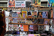 Old sign stall on Portobello Road market, Notting Hill, West London. This famous Sunday market is when the antique stalls come out as well as the food stalls.