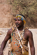 Portrait of a Hadza hunter. The Hadza, or Hadzabe, are an ethnic group in north-central tanzania, living around Lake Eyasi in the Central Rift Valley and in the neighboring Serengeti Plateau. Tanzania, Africa