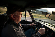 Image of a man driving his 1972 Porsche 911 ST Tribute car down the road in central California near Paso Robles at the R Gruppe Treffen event, America west coast by Randy Wells
