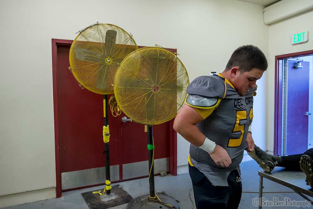 Del Oro Golden Eagle's Dalton Heryford (51), gets ready inside the locker room before the game as the Del Oro Golden Eagles varsity football team host the Oak Ridge Trojans, Friday Oct 21, 2016.<br /> photo by Brian Baer