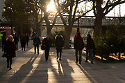 Sun setting behind trees casting low shadows on the riverside walkway on the Southbank, London, United Kingdom. The South Bank is a significant arts and entertainment district, and home to an endless list of activities for Londoners, visitors and tourists alike. (photo by Mike Kemp/In Pictures via Getty Images)