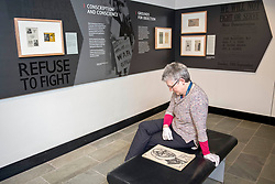 A new exhibition, Conscience Matters, opened at the National War Museum in Edinburgh today. Friday 8 March, exploring the little-known story of British conscientious objectors of the Second World War. The exhibition explores some of the reasons people have refused to take up arms during war and how such refusals are perceived by society. <br /> Pictured: Exhibition Curator Dorothy Kidd with work done by artist Edwin Lucas, one of the people whose stories feature in the exhibition<br /> <br /> <br /> © Jon Davey/ EEm