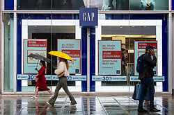 © Licensed to London News Pictures. 30/07/2021. LONDON, UK.  People pass the GAP store on Oxford Street which will be closing soon. According to a report from the British Retail Consortium (BRC) and Local Data Company, one in seven shops across Britain is empty as retailers continue to suffer the effects of the Covid pandemic on footfall and customers move to online shopping.  There is a sharp divide between the south of England, including London, with lower vacancy rates compared to the north of the country.  Photo credit: Stephen Chung/LNP