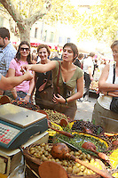 The Saturday market in Uzès, Languedoc, France..October 6, 2007..Photo by Owen Franken for the NY Times...Assignment ID: 30049869AThe Saturday market in Uzes, Languedoc, France..buying olives..October 6, 2007..Photo by Owen Franken for the NY Times...Assignment ID: 30049869A