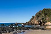 Nobbys Beach, Port Macquarie, a local dog friendly beach. Photo of the 30 M high Nobby Head.