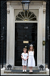 Nancy and Elwin on the steps of No10 Downing Street, Tuesday August 3, 2010. Photo By Andrew Parsons