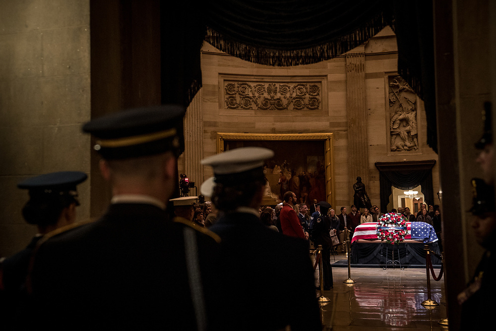 A Marine Corps honor guard prepares to watch over the casket of Former President George H.W. Bush as it lies in state at the U.S. Capitol on Dec. 3, 2018.