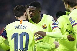 February 19, 2019 - Lyon, France - Moussa Dimbele and Lionel Messi during the UEFA Champions League round of 16 first leg football match between Lyon (OL) and FC Barcelona on February 19, 2019, at the Groupama Stadium in Decines-Charpieu, central-eastern France. (Credit Image: © Mehdi Taamallah/NurPhoto via ZUMA Press)