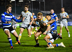 Anthony Watson of Bath Rugby attempts a tackle on Tom Cruse of Wasps - Mandatory by-line: Andy Watts/JMP - 08/01/2021 - RUGBY - Recreation Ground - Bath, England - Bath Rugby v Wasps - Gallagher Premiership Rugby