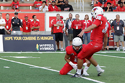 NORMAL, IL - September 01: Spencer Schnell holds the ball for a point after attempt by Sam Fenlason during a college football game between the ISU (Illinois State University) Redbirds and the Saint Xavier Cougars on September 01 2018 at Hancock Stadium in Normal, IL. (Photo by Alan Look)