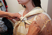 Israel The Hina, also Henna ceremony proceeds the wedding day. In this festive ceremony, natural red dye is applied on the hands of the participants especially the bride and groom, to symbolize happiness, wealth and a successful union of the young couple. Bride to be is being dressed up