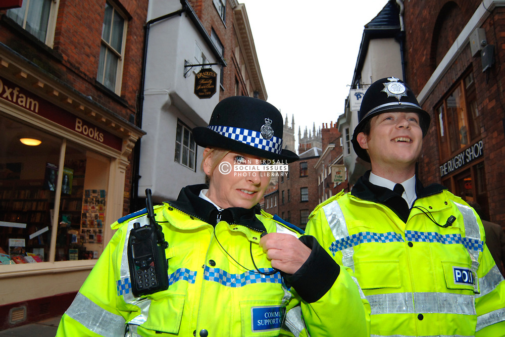 Policeman and Community Support Officer patrolling the streets of York; UK