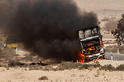 Flames and smoke engulf a burning truck. The truck wad ignited by a kite bomb dispatched from Gaza. Photographed on the Israel Gaza Border in April 2012