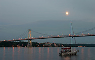 Highland, N.Y. - A sail boat lies at anchor on the Hudson River just north of the Mid-Hudson Bridge on July 8, 2006. ©Tom Bushey
