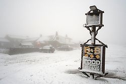 © Licensed to London News Pictures. 27/01/2014 North York Moors, England The Lion Inn pub high up on Blakey Ridge on the North York Moors is shrouded in early morning fog after another night of snow and freezing temperatures. Photo credit : Ian Forsyth/LNP