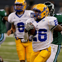 Sep 26, 2009; New Orleans, LA, USA; McNesse State Cowboys running back Champlain Babin (26) runs a kickoff back for a touchdown against the Tulane Green Wave in the second half but the play was nullified by a penalty at the Louisiana Superdome. Tulane defeated McNeese State 42-32. Mandatory Credit: Derick E. Hingle-US PRESSWIRE