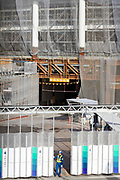 A security guard at a gate for the construction site of the new National Stadium rises as preparations for the 2020 Tokyo Olympics continue in Gaiemmae, Tokyo, Japan. Friday May 25th 2018