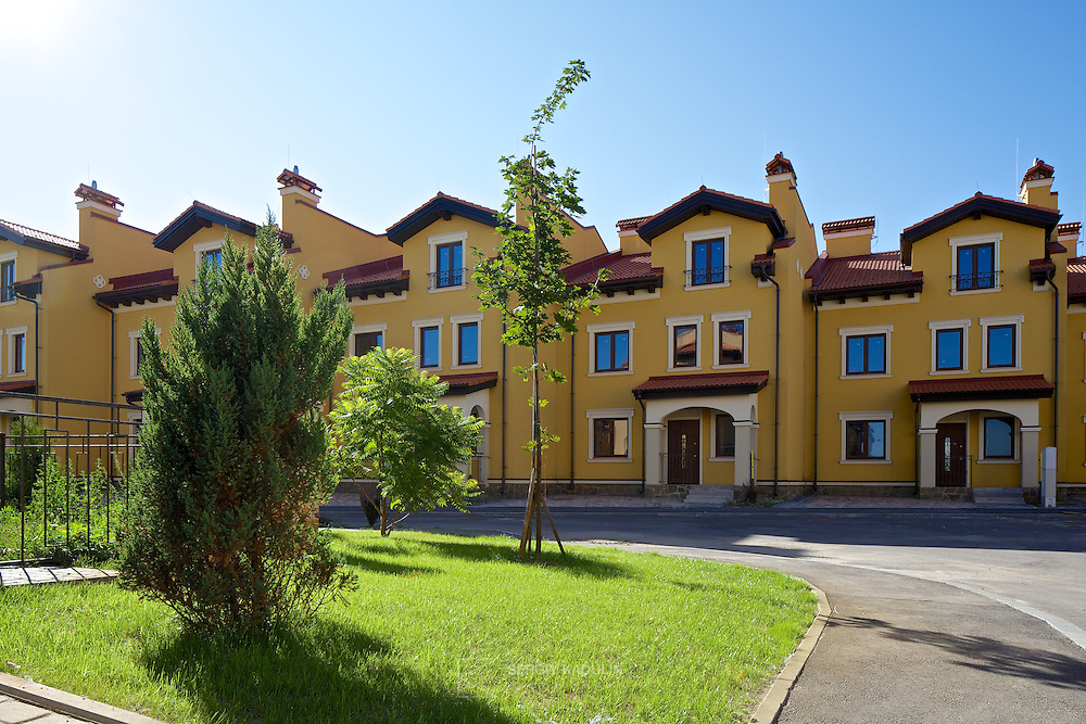 """Townhouses real estate in """"Italian Village"""" residential development project in Kyiv, Ukraine. Exterior view with the daylight."""