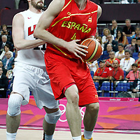 12 August 2012: Spain Pau Gasol drives past Kevin Love during 107-100 Team USA victory over Team Spain, during the men's Gold Medal Game, at the North Greenwich Arena, in London, Great Britain.