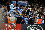Santiago Cordero of Argentina runs to celebrate with Argentina fans at end of match. Rugby World Cup 2015 quarter-final match, Ireland v Argentina at the Millennium Stadium in Cardiff, South Wales  on Sunday 18th October 2015.<br /> pic by  Andrew Orchard, Andrew Orchard sports photography.