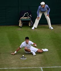 © Licensed to London News Pictures. 25/06/2014. LONDON, UK Wimbledon Tennis Championships 2014<br /> Day 3. Novak Djookovic, SRB v Radek Stepanek, CZE on Centre Court  Photo credit : Mike King/LNP
