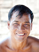 A portrait of a man living in the floating village of Kompong Phluk on the great Tonlé Sap lake, Cambodia