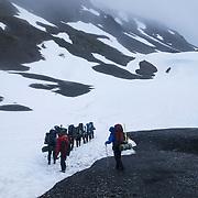 Hikers walk down on the Harding Icefield trail at the Kenai Fjords National Park in Seward, Alaska, on Thursday, August 4, 2016. (Alex Menendez via AP)