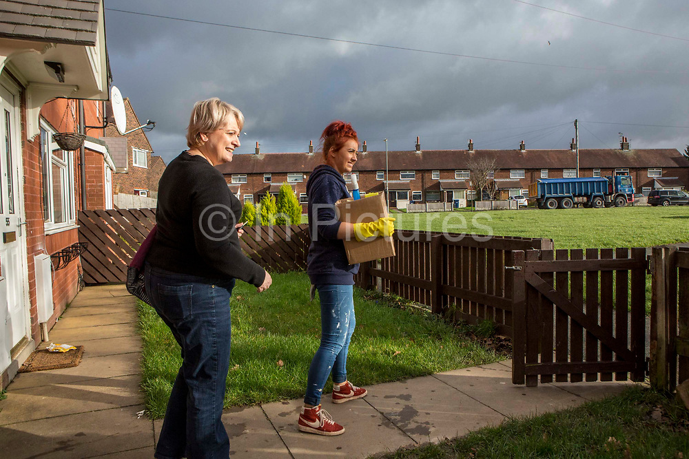 Volunteers from Longton Community Church working on rubbish removal from a house to improve the lives of those in need in their local community, Leyland, Lancashire.