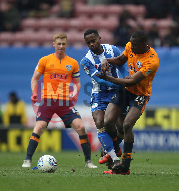 Gavin Massey of Wigan Athletic (L) and Ousmane Fane of Oldham Athletic in action - Mandatory by-line: Jack Phillips/JMP - 30/03/2018 - FOOTBALL - DW Stadium - Wigan, England - Wigan Athletic v Oldham Athletic - Football League One