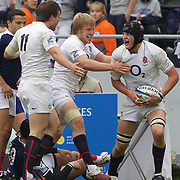 Jamie Gibson, England, is congratulated by team mates Sam Smith, (left) and Jacko Wray (centre) after scoring  the only try of the match during England Victory over France during the England V France group stage match at Estadio El Coloso del Parque, Rosario, Argentina, during the IRB Junior World Championships. 13th June 2010. Photo Tim Clayton....