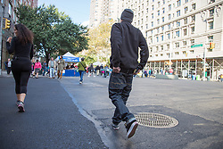 man walking down the street in New York City with his jeans falling down