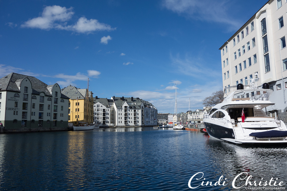 Boats are berthed close to buildings along the the waterfront in Ålesund, Norway, on May 14, 2013.   (© 2013 Cindi Christie)