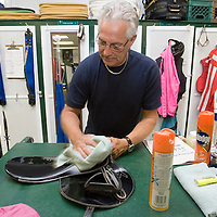 (PPAGE1) Oceanport 5/14/2005 Frank Salerno of Chrerry Hill who is a Jocky Vallet works on some gear in the jockey lounge before the first race.     Michael J. Treola Staff Photographer....MJT
