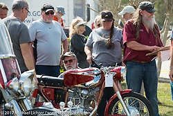 An antique Ducati gets judged at the AMCA Sunshine Chapter Swap Meet during Daytona Beach Bike Week. FL. USA. Saturday March 11, 2017. Photography ©2017 Michael Lichter.
