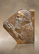 Stone relief sculptured panel of a man. From corridor 10,  Inv AO 19896 from Dur Sharrukin the palace of Assyrian king Sargon II at Khorsabad, 713-706 BC.  Louvre Museum Room 4 , Paris .<br /> <br /> If you prefer to buy from our ALAMY PHOTO LIBRARY  Collection visit : https://www.alamy.com/portfolio/paul-williams-funkystock/ancient-assyria-antiquities.html  Refine search by adding background colour, place, subject, museum etc into the LOWER SEARCH WITHIN GALLERY box to <br /> <br /> Visit our ANCIENT WORLD PHOTO COLLECTIONS for more photos to download or buy as wall art prints https://funkystock.photoshelter.com/gallery-collection/Ancient-World-Art-Antiquities-Historic-Sites-Pictures-Images-of/C00006u26yqSkDOM