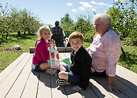 Taking a tractor ride at Smith Orchard in Belmont.  (Karen Bobotas Photographer)