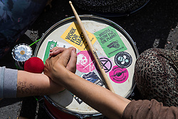 Extinction Rebellion activists link arms across a samba drum after a road junction to the south of London Bridge was blocked using a vintage bus on 31st August 2021 in London, United Kingdom. Extinction Rebellion are calling on the UK government to cease all new fossil fuel investment with immediate effect.