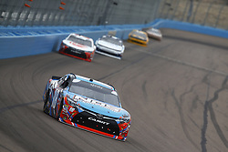 March 10, 2018 - Avondale, Arizona, United States of America - March 10, 2018 - Avondale, Arizona, USA: Kyle Busch (18) brings his race car down the front stretch during the DC Solar 200 at ISM Raceway in Avondale, Arizona. (Credit Image: © Chris Owens Asp Inc/ASP via ZUMA Wire)