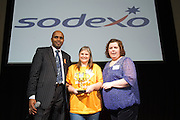 """16/02/2014  Paul Sleem MC with Outstanding Volunteer<br /> Sabrina Autier, SAP presented by  Yvonne Butler, Sodexo at the 8th annual SAP FIRST LEGO League challenge in Galway! The global theme for this year's competition; """"Nature's Fury"""" was very apt for Irish Students and many of the projects were inspired by recent disastrous impact of the weather in local communities.<br /> <br /> The winners, SGC Robotics from St. Gerald's Secondary School in Castlebar, will now go on to represent Ireland at the European finals of the competition in Spain in May. They will follow in the footsteps of other very successful Irish teams who have in the past been recognised and awarded prizes on the international stage.<br /> Bernard Kirk, Director, The Galway Education Centre who brought the FIRST LEGO League to Ireland 8 years ago and have hosted it every year since, """" We see these students not just as LEGO and robotics experts, they are architects, engineers and genuine enthusiasts. Irish students have become recognised all over the world through their successes in this competition at global level and we are extremely proud of them and their teachers"""". Photo:Andrew Downes"""