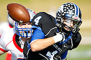 Plano West's Connor Doyle (4) loses the ball while being tackled by Austin Westlake's John Dodd (8) in the Class 5A Division II Region II playoff final at the Waco ISD Stadium in Waco, Texas on December 8, 2012.  (Stan Olszewski/The Dallas Morning News)