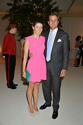EMERALD FRASER and ANTONIO DEL BALZO  at a dinner hosted by Cartier in celebration of The Chelsea Flower Show held at The Hurligham Club, London on 19th May 2014.