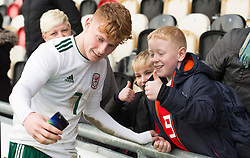 NEWPORT, WALES - Tuesday, November 19, 2019: Wales' Samuel Pearson takes a selfie with a young spectator after  the UEFA Under-19 Championship Qualifying Group 5 match between Kosovo and Wales at Rodney Parade where Wales won 2-0. (Pic by Laura Malkin/Propaganda)