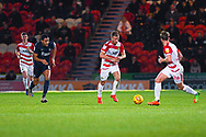 Herbie Kane of Doncaster Rovers (15) shapes to pass the ball long under pressure from Timothee Dieng of Southend United (8) during the EFL Sky Bet League 1 match between Doncaster Rovers and Southend United at the Keepmoat Stadium, Doncaster, England on 12 February 2019.
